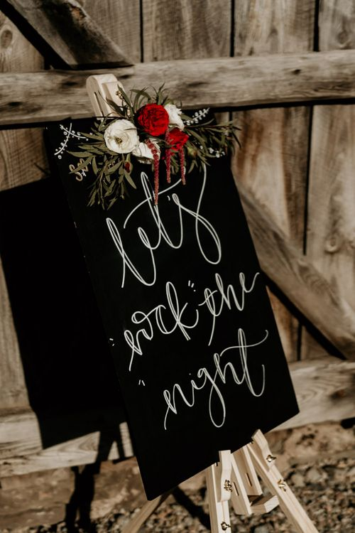 Black Wedding Sign with Floral Decor