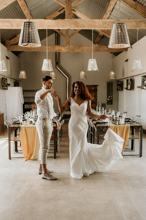 Black Bride in Lace Wedding Dress Being Twirled by Her Groom in  Skinny Trouser, White Shirt & Loafers