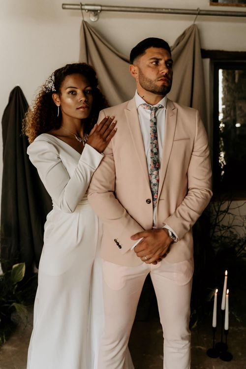 Black Bride with Afro Hair  in White Jumpsuit with Groom in Pink Blazer and Floral Tie
