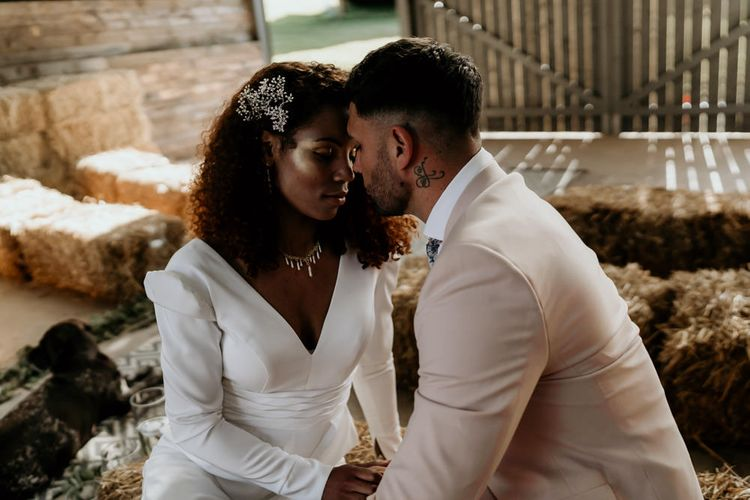 Black Bride with Afro Hair in Jumpsuit and Groom in Pink Blazer