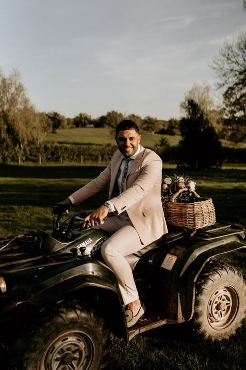 Groom in Pink Suit Riding a Quad Bike
