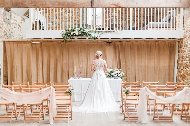 Bride at the Altar in Lace Bardot Gown | Blush Pink, Romantic, Country Wedding Inspiration at Tithe Barn, Dorset | Darima Frampton Photography
