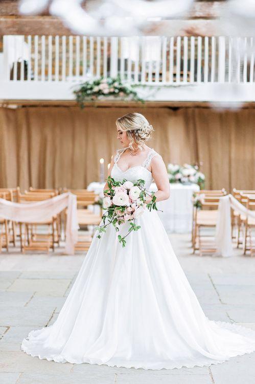 Bride at the Altar in Princess Wedding Dress |  Pink Ranunculus Bridal Bouquet | Blush Pink, Romantic, Country Wedding Inspiration at Tithe Barn, Dorset | Darima Frampton Photography
