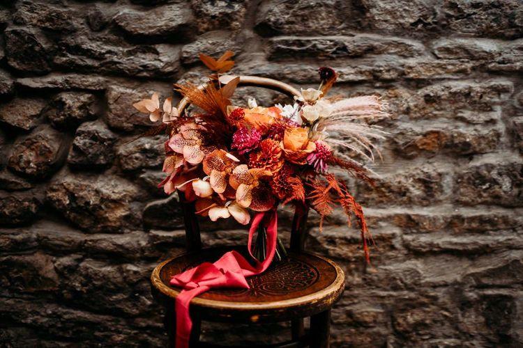 Caramel, raspberry and rust wedding theme bouquet
