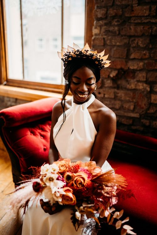 Beautiful bride in halter neck Halfpenny London wedding dress and Hermione Harbutt headdresss