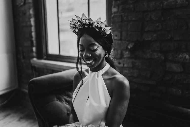 Black and white portrait of bride in halter neck wedding dress and bridal crown