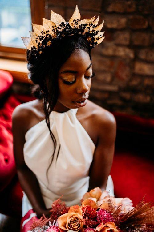 Black bride wedding makeup with gold eyeshadow