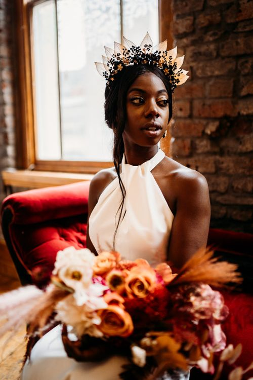 Black and gold Hermione Harbutt headdress for rust wedding theme