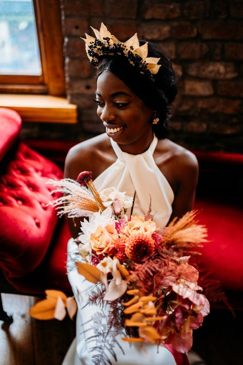 Caramel, Raspberry and rust wedding theme floral bouquet