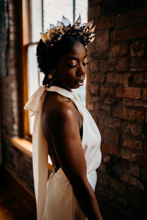 Modern bride in halter neck wedding dress and gold leaf bridal crown
