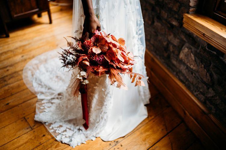 Caramel, rapsberry and rust wedding theme flowers