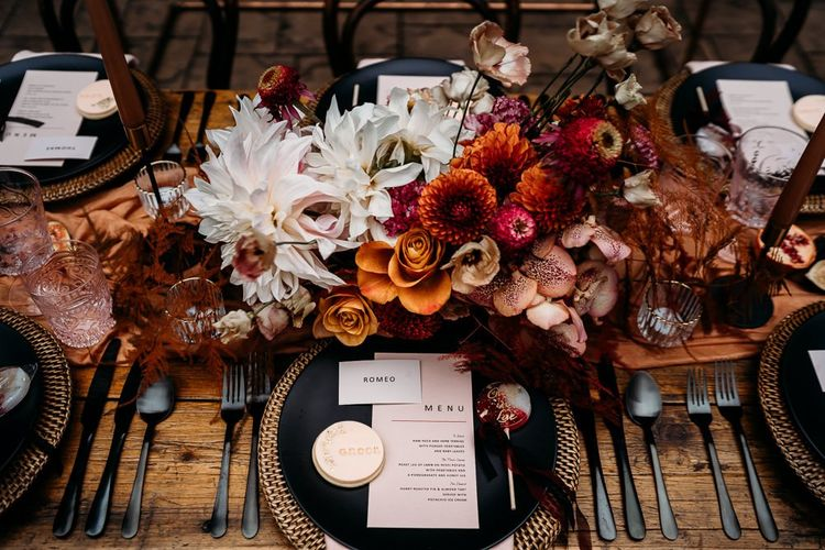 Floral centrepiece with caramel, raspberry and rust theme decor