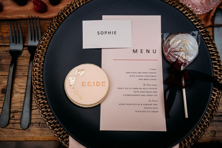 Menu card, biscuit favour, lollipop and name place setting