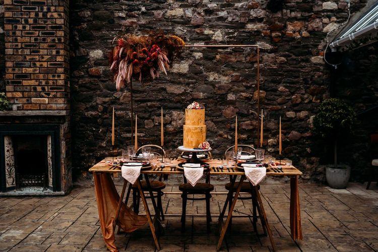 Caramel, raspberry and rust wedding theme for bohemian luxury wedding