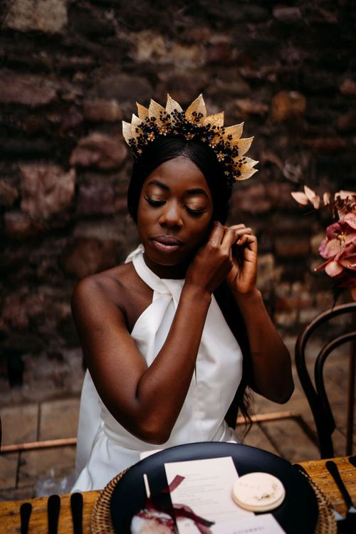 Beautiful bride in Hermione Harbutt bridal crown for rust wedding theme