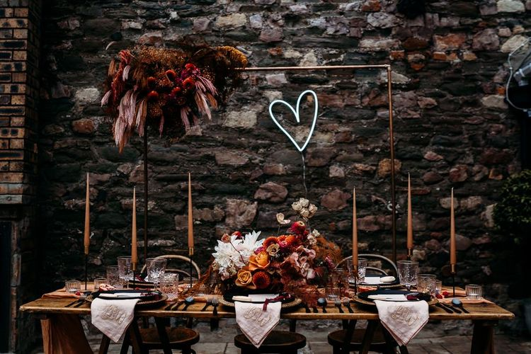 Embroidered napkins and neon sign decorating the luxury table scape