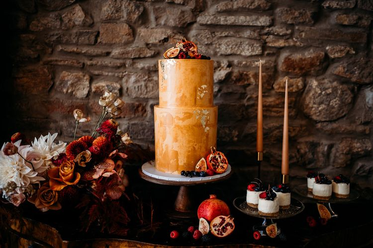 Dessert table with rust coloured wedding cake for rust wedding theme