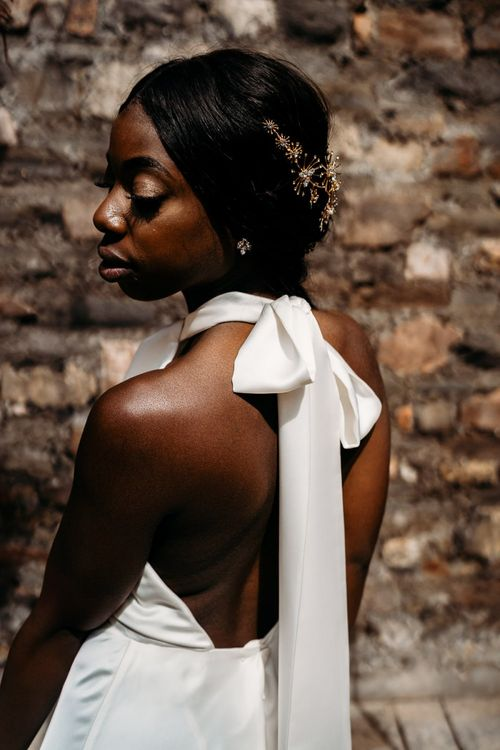 Bride in halter neck wedding dress