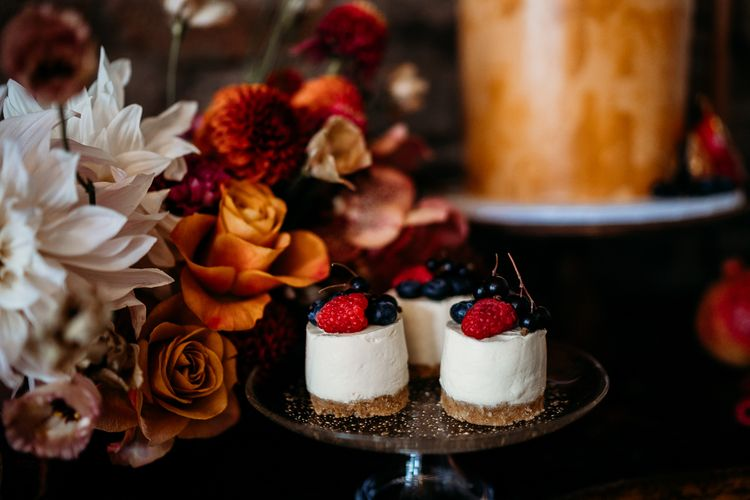 Individual cheesecakes on dessert table