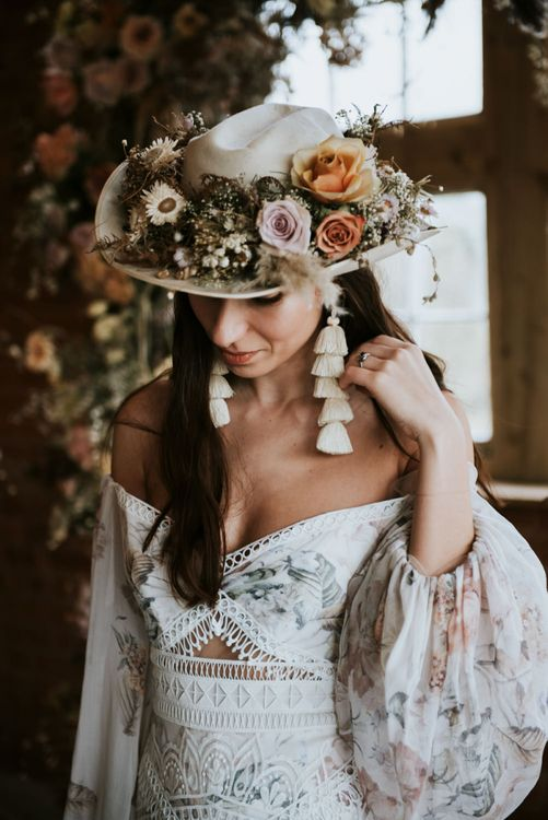 Fedora hat covered in dried flowers and tassel earrings. . Boho wedding dresses