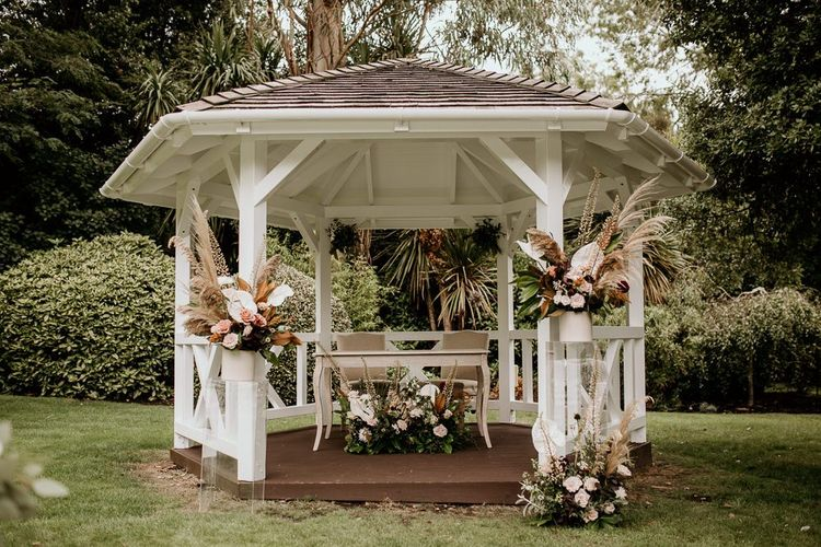Wooden gazebo wedding altar