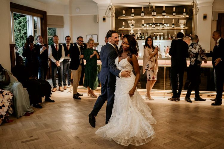 First dance with black bride in Riki Dalal wedding dress and Irish Groom in navy suit