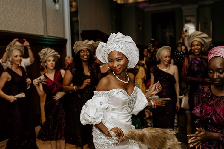 Nigerian bride in traditional dress at money dance