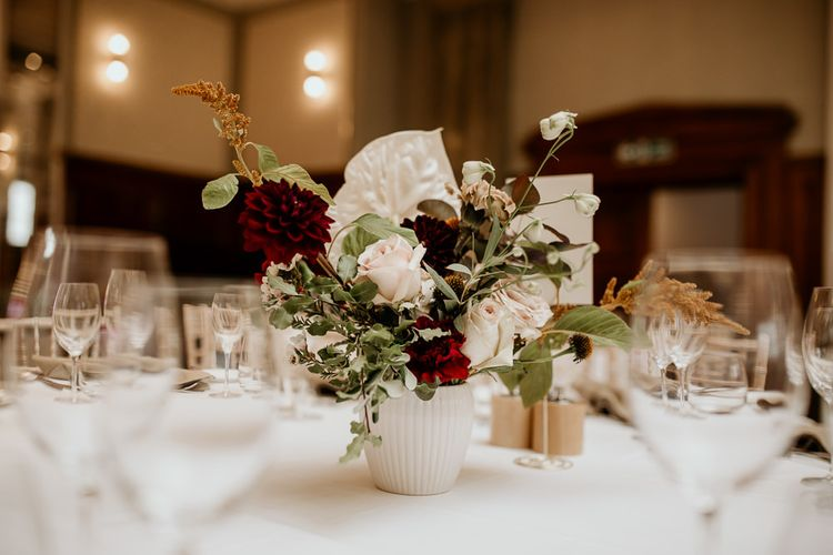 White vase flower centrepiece with roses