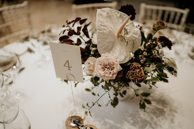 Flower Centrepiece with white tropical Anthurium flowers and roses