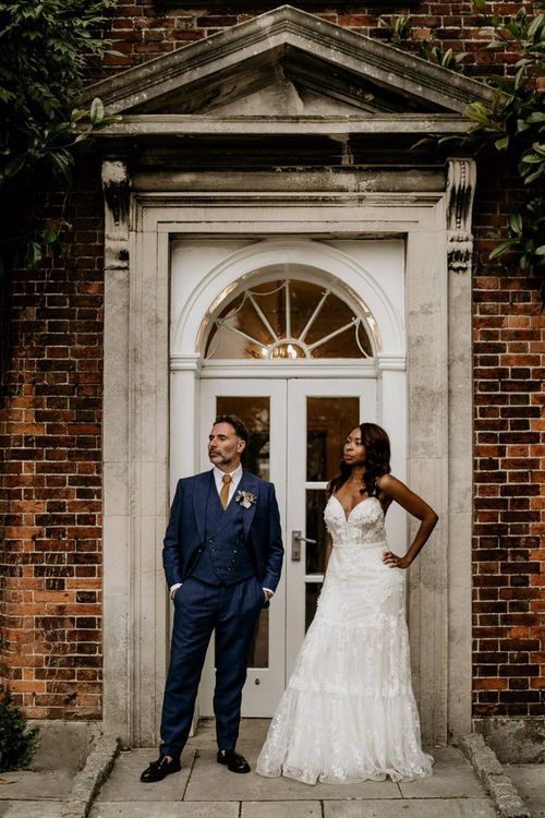 Nigerian bride in Riki Dalal wedding dress and Irish Groom Blue Suit