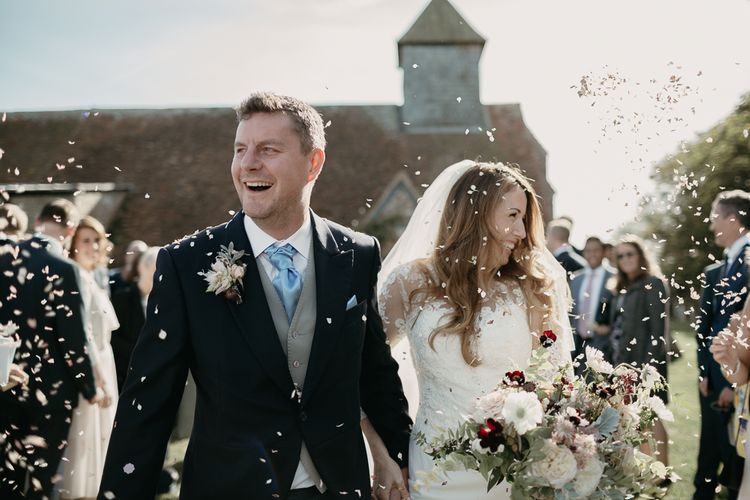 Confetti Moment with Bride in Lace St Partrick Wedding Dress and Groom in Morning Suit
