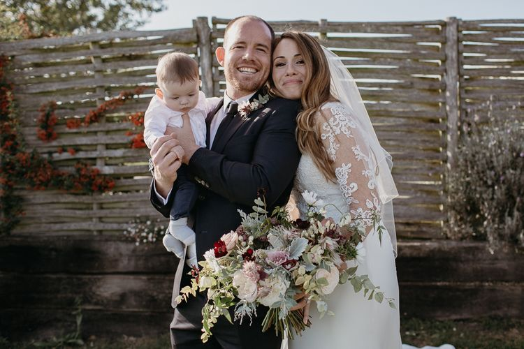 Bride in La Sposa Wedding Dress with Lace Long Sleeves Posing with Wedding Guests
