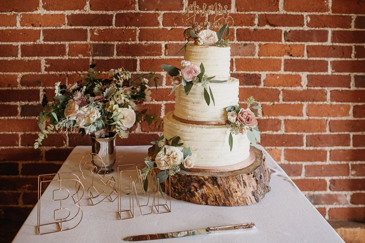 Buttercream Wedding Cake on Log Slice Cake Stand
