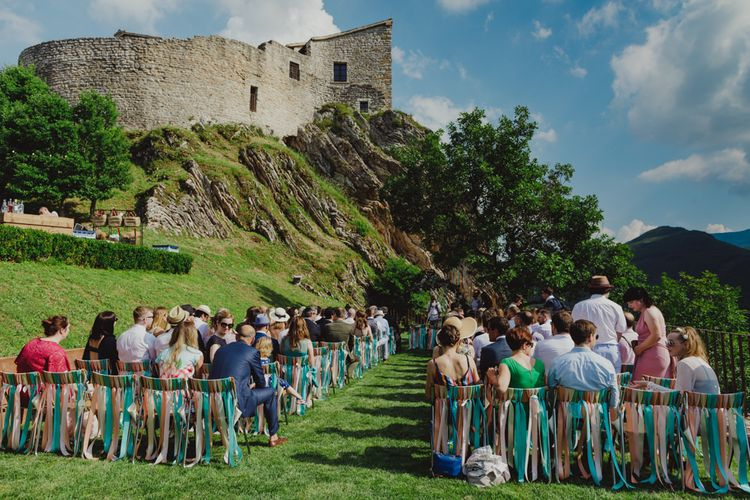 Outdoor Wedding Ceremony at Castello di Naro in Italy with Ribbon Chair Back Detail