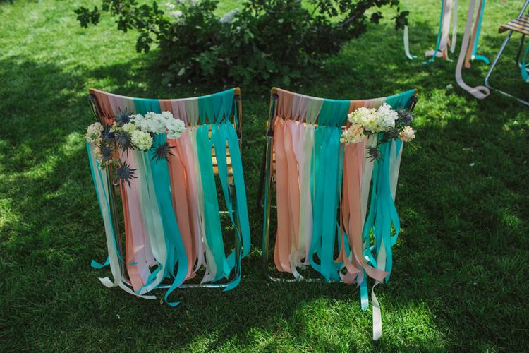 Altar Chairs Decorated with Colourful Ribbons and Flowers