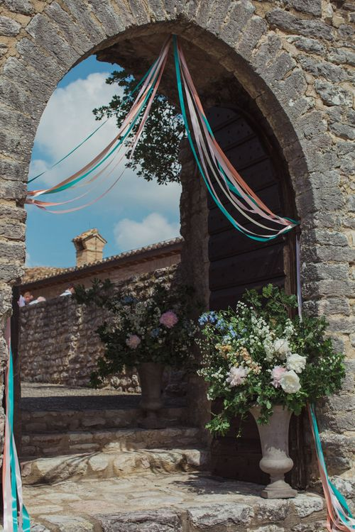 Entrance Decorated in Ribbons and Pastel Floral Arrangement