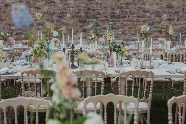 Outdoor Wedding Reception with Pastel Flowers in Vases and Candelabras