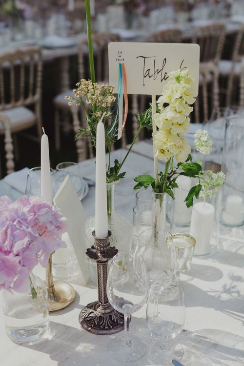 Table Centrepiece Decor Including Candlestick and Flower Stems in Vases