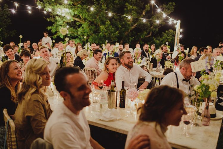 Wedding Guests Laughing During Wedding Reception Speeches