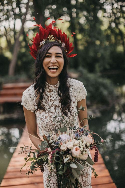 Bride in Red Feather Bridal Crown
