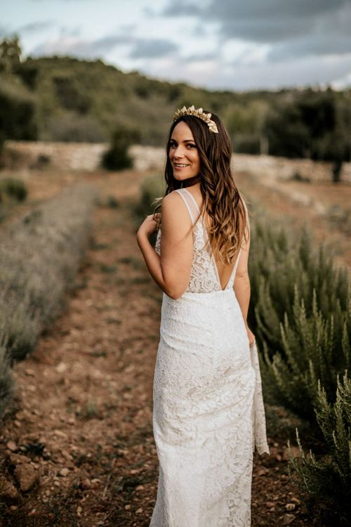 Bride with long wavy hair and gold headdress