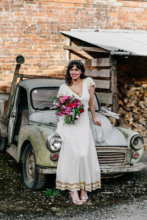 Bride in Vintage Wedding Dress with Gold Trim and Gold Headdress