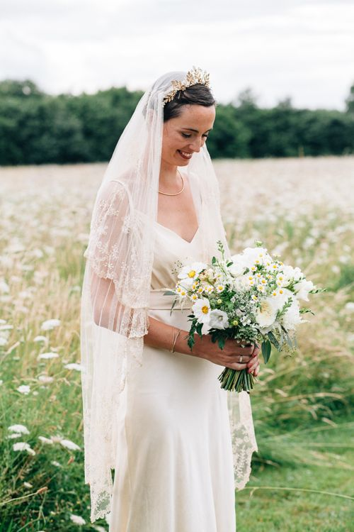 Bride in lace veil and crown