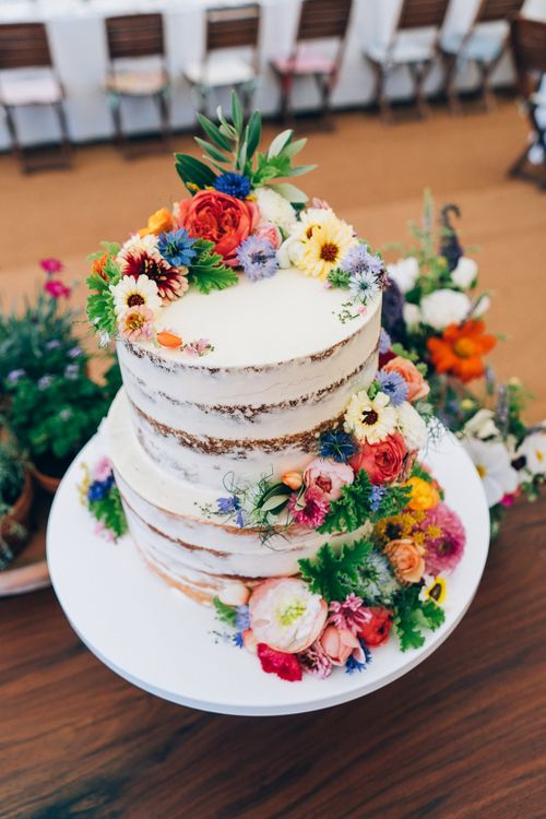 Naked Wedding Cake With Wild Flower Decor // Images By Casey Avenue Photography