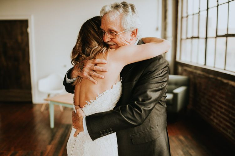 Father of the Bride and His Daughter Hugging at the First Look