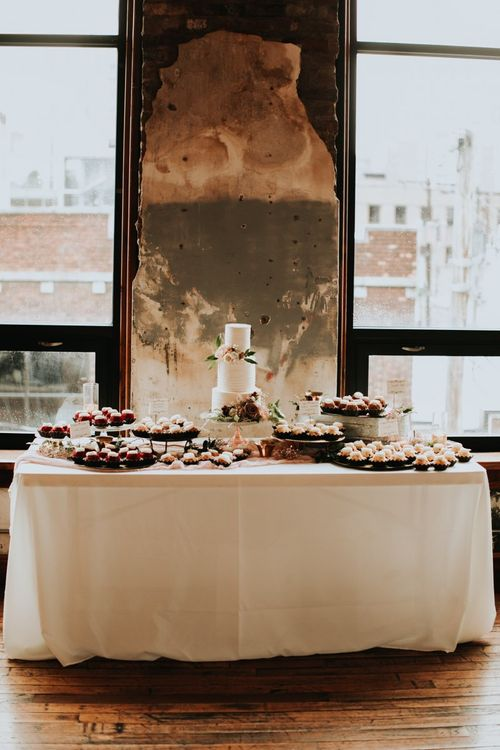 Dessert Table with Wedding Cake and Individual Treats
