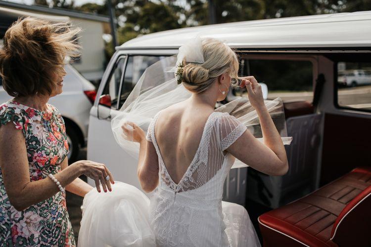 Bride in Beaded Rosa Clara Wedding Dress Getting into a VW Camper Van