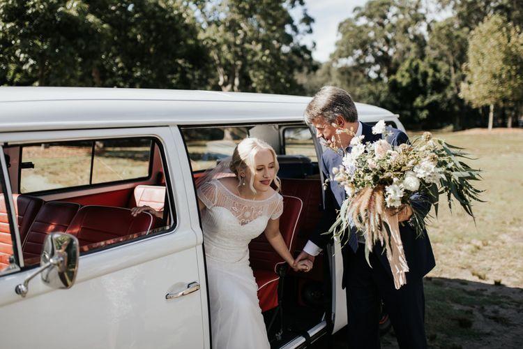 Bride in Beaded Rosa Clara Wedding Dress Getting out of VW Camper Van