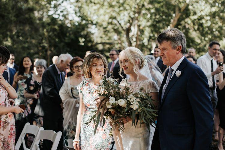 Outdoor Wedding Ceremony Bridal Entrance in Rosa Clara Wedding Dress