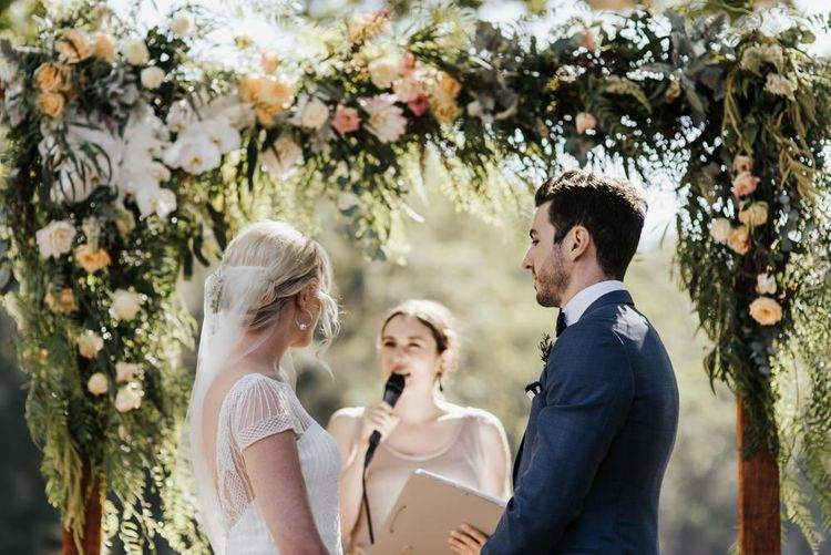 Outdoor Wedding Ceremony with Bride and Groom Exchanging Vows